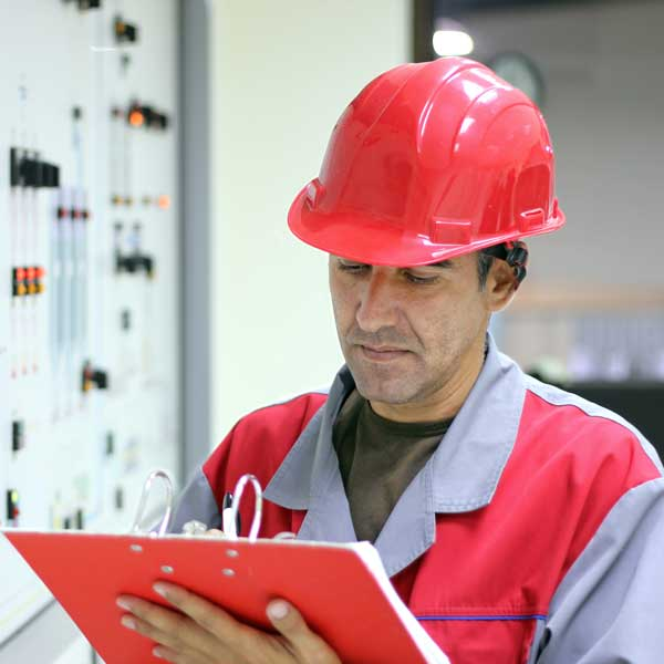 Chemical Engineer Reviewing Numbers at Facility